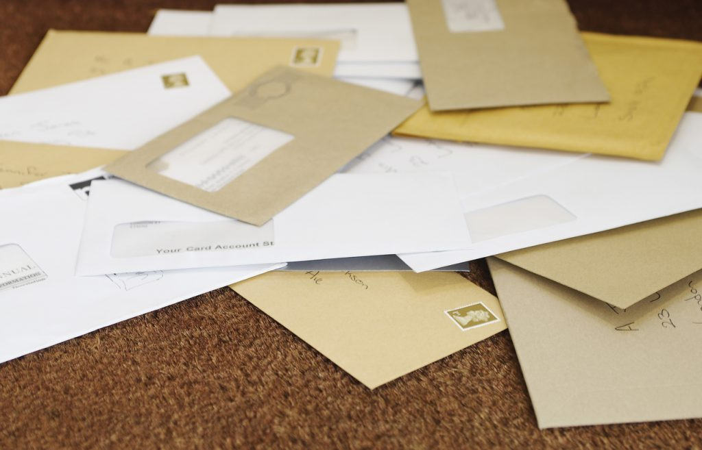 Pile Of Mail On Doormat - security risk